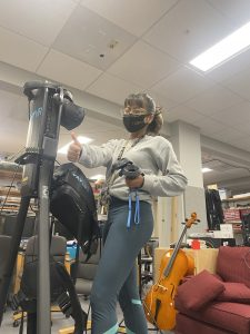 """Geela working on synching her lab's omnidirectional treadmill with a virtual reality system. These two systems are integral to the """"Force Feedback for Virtual Reality"""" efforts."""