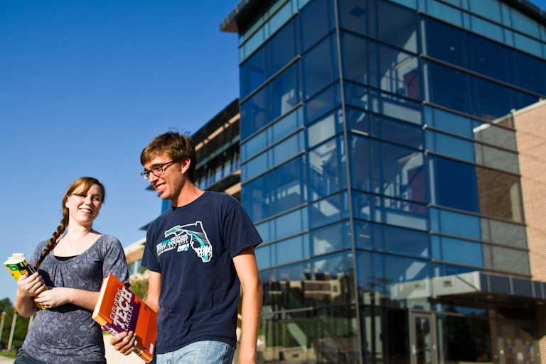 Students walking in front of Career Services and Experiential Learning Building